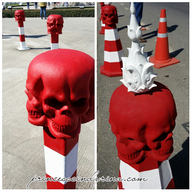 red skulls on street barriers and street cones