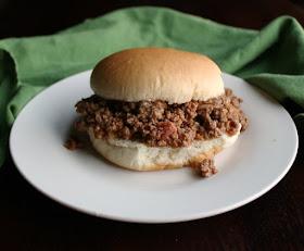 close up of sloppy joe filling on hamburger bun