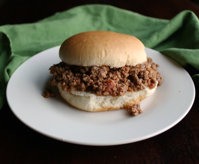 close up of sloppy joe filling on hamburger bun
