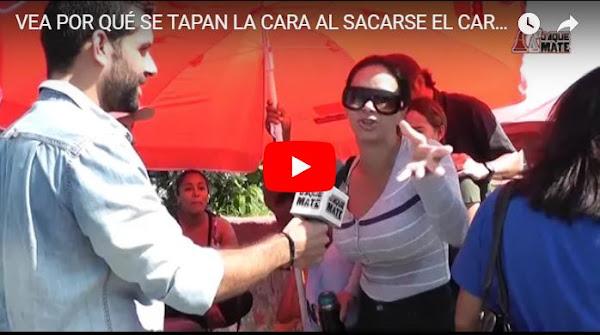 Decenas de opositores en fila para sacarse el Carnet del Chantaje y tapándose la cara