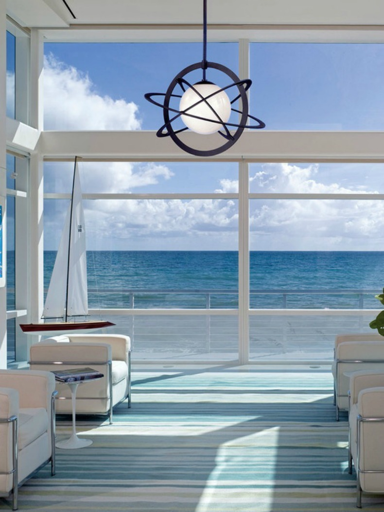 Coastal modern living room with white modern chairs and ocean view
