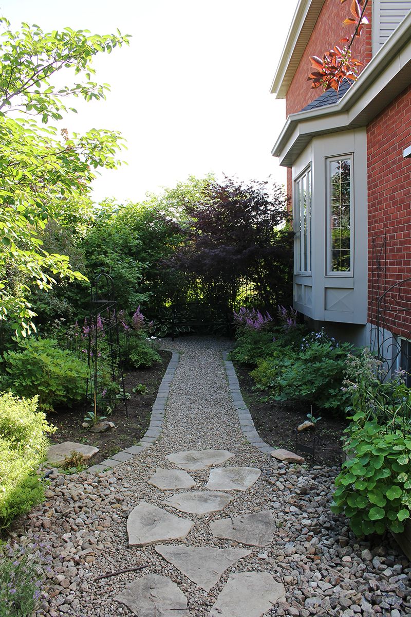 Garden pathway and perennials by Kathleen Maunder of Trowel and Paintbrush