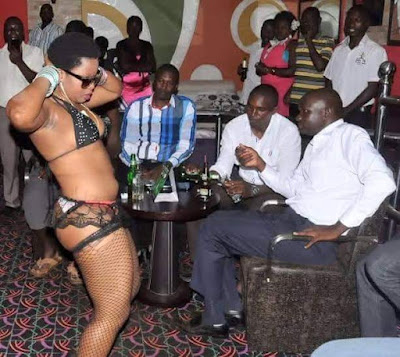 Photos: Ugandan lawmaker and his friends spotted watching nearly naked woman dance at a bar