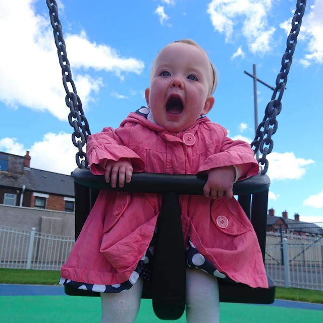 Scarlet playing on the swings during A trip to the park. Free days out this summer. Us Two Plus You