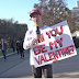 He wears MAGA hat, holds sign asking college women if they'll be his 'Valentine.' You already know their answers.