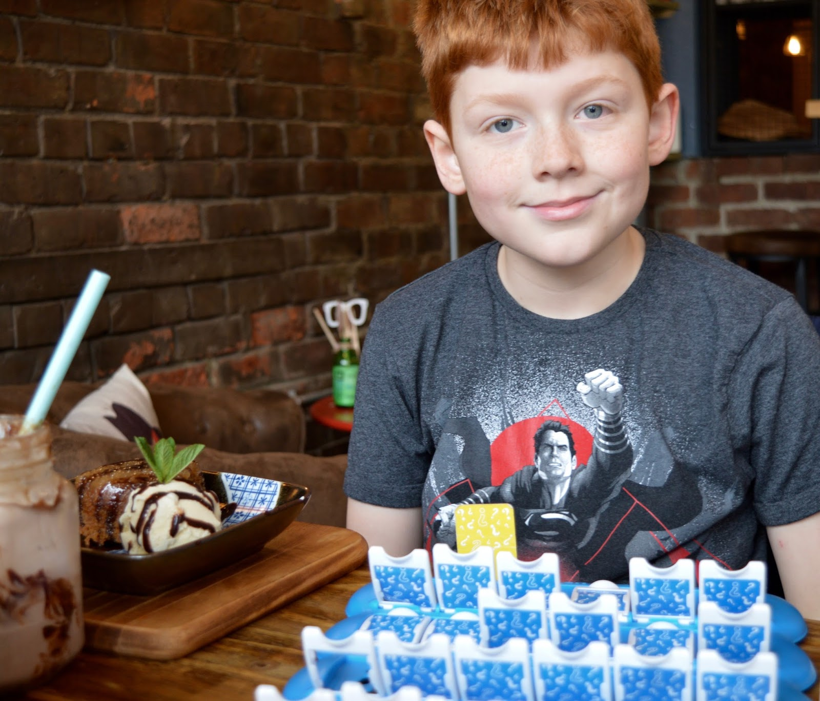 Meet and Treat Newcastle Cafe | A Perfect Spot for Pre-Theatre Drinks & Cakes with Kids for Tyne Theatre and Opera House - Harry playing Guess Who