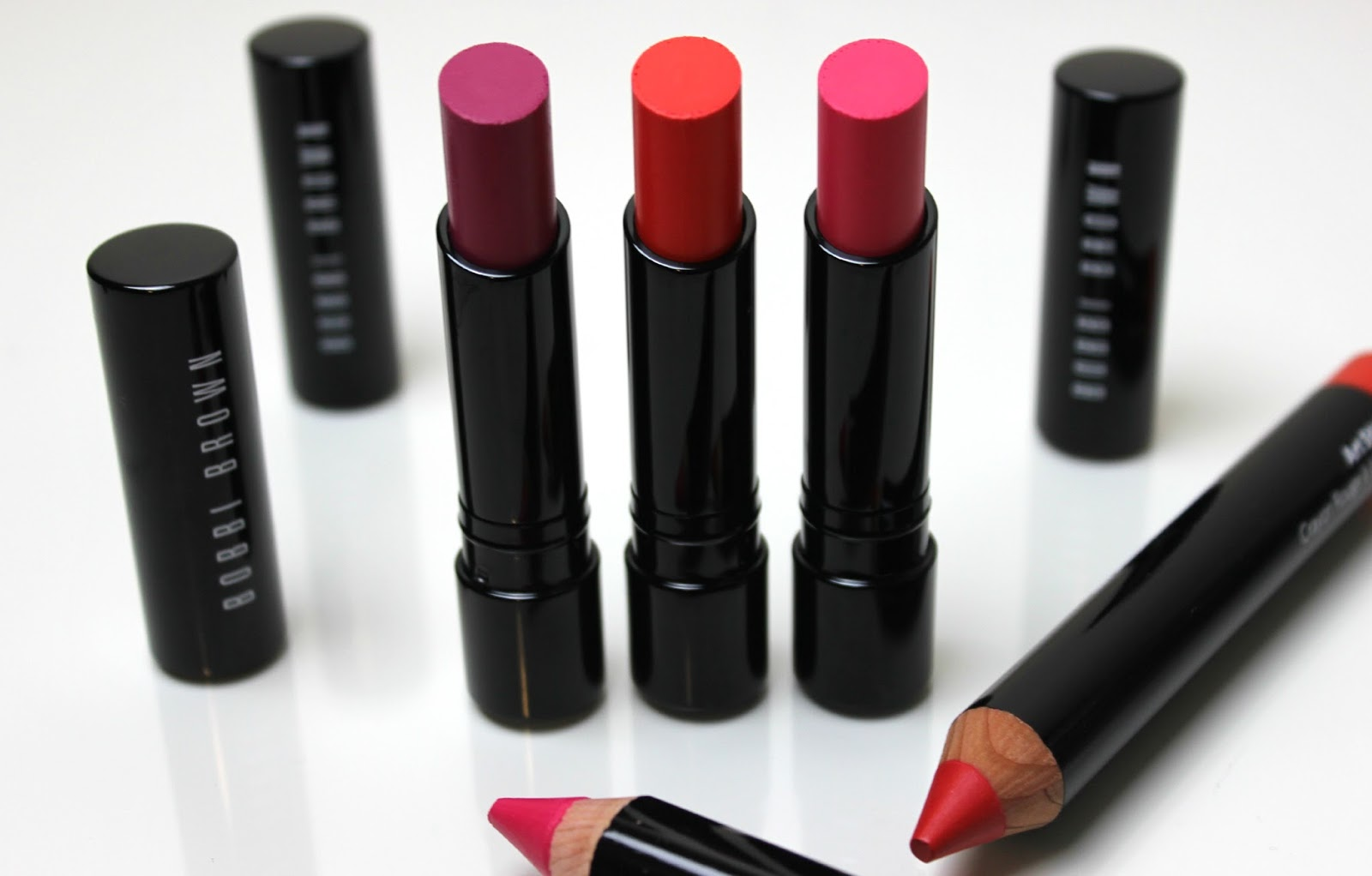 A picture of Bobbi Brown Sheer Lip Color Shade Extensions in Berry, Pink and Orange