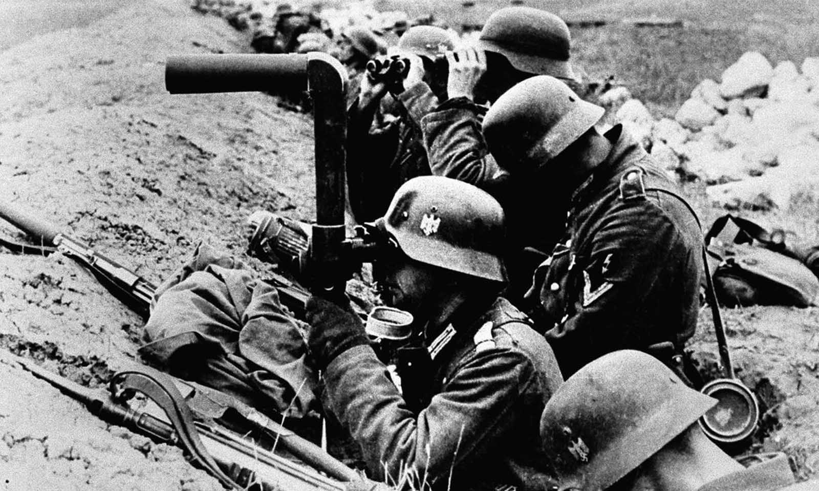 German infantrymen watch enemy movements from their trenches shortly before an advance inside Soviet territory, on July 10, 1941.
