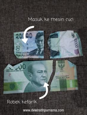 menukar uang robek