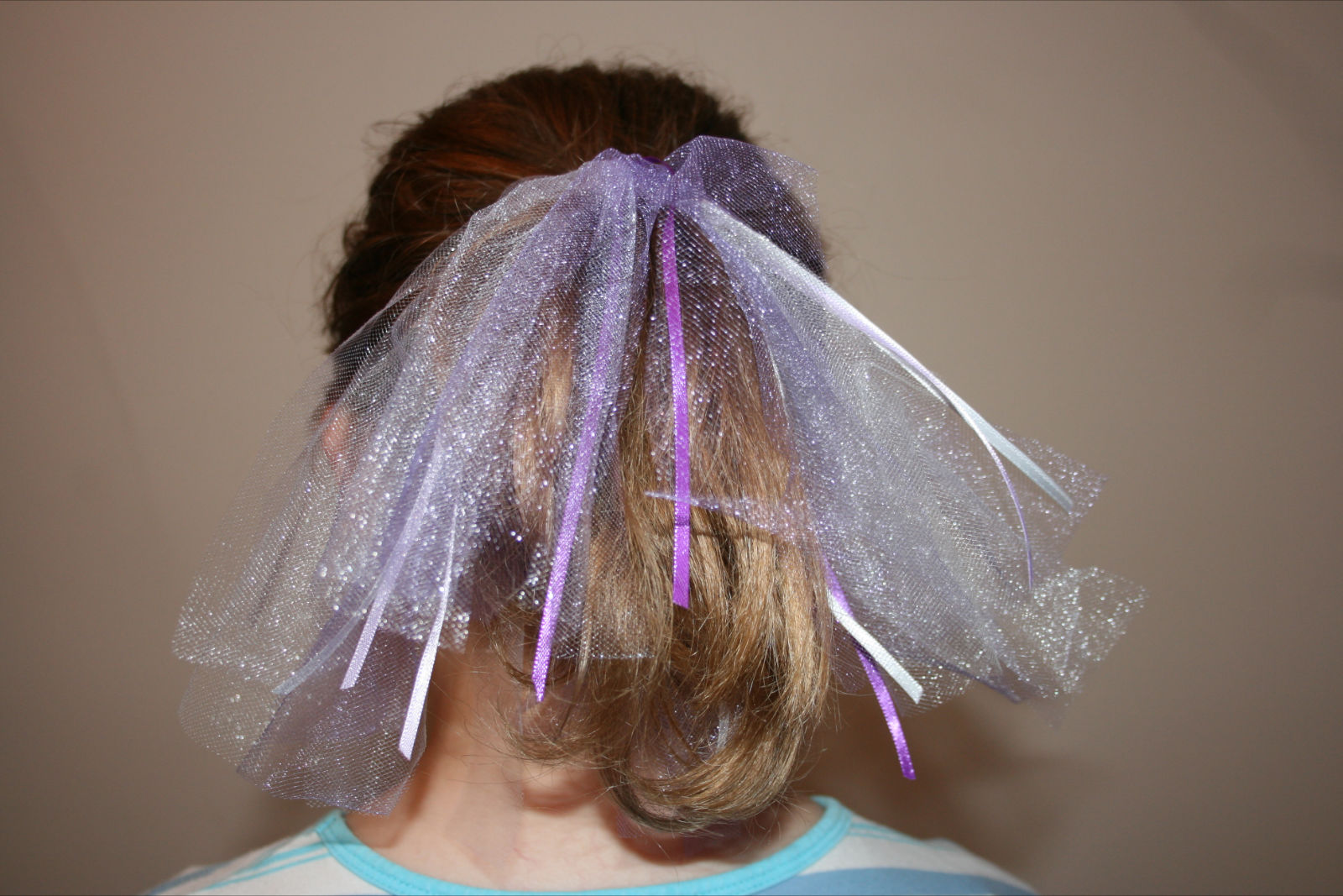 Continue this pattern around the hair tie the last two strips of tulle you  tie on fe9616cb7b3