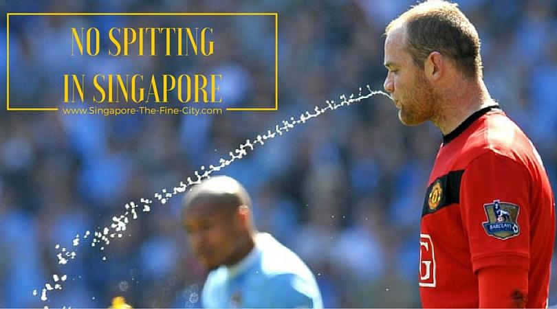 Wayne Rooney spitting on the football field