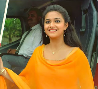 Keerthy Suresh in Orange Dress with Cute and Awesome Lovely Chubby Cheeks Smile in Saamy Square