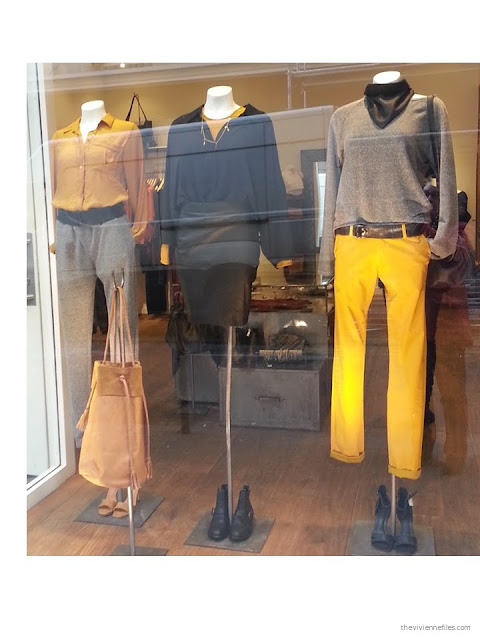 Grey and black color scheme, with mustard yellow as an accent color