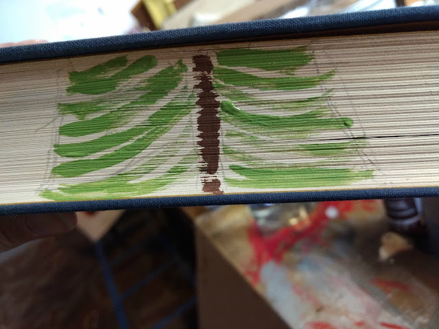 paint a pine tree on old books for christmas decoration