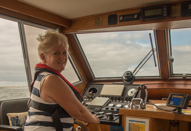 Photo of me at the helm of Ravensdale in the Solway Firth