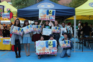 people holding barbados flag in Japan