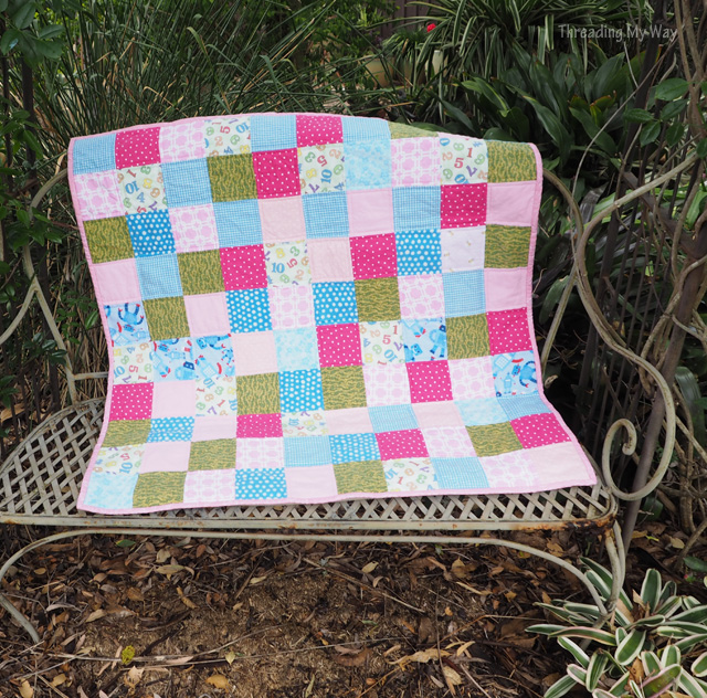 Scrap busting flannelette quilt made with small sqares of fabric ~ Threading My Way