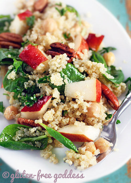 Karina's quinoa salad recipe with baby spinach, pears, and chick peas, with pecans and maple vinaigrette is gluten-free and vegan.