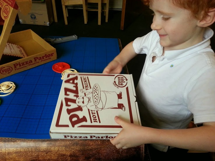 Green Toys 100% recycled cardboard toy Pizza Parlour Review boy with pizza box