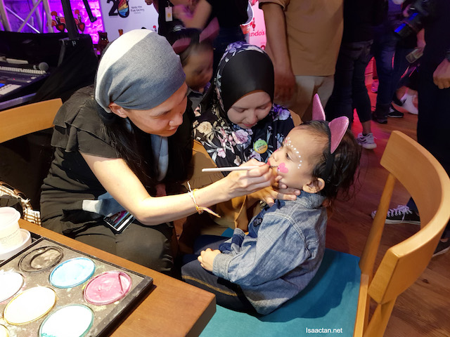 Kids having a blast having their face painted at Nando's birthday bash