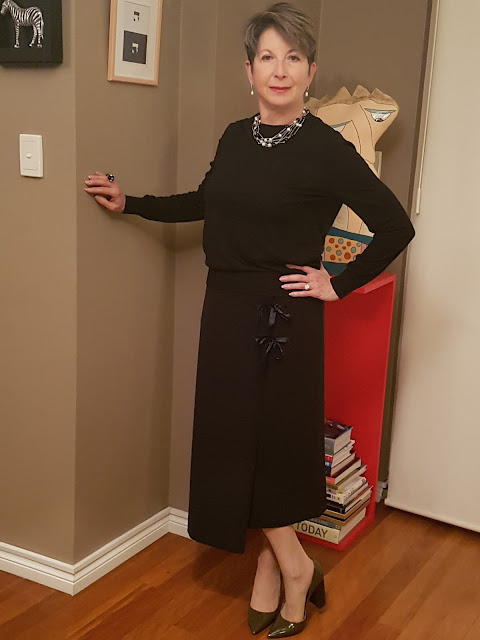 Black midi-skirt-black-cashmere sweater-long-black-coat-high-heel-shoes