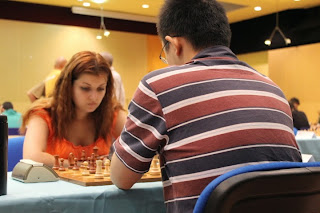 Ni Hua (2674) 1/2 Evgeniya Doluhanova (2334) - Photo © Chess & Strategy