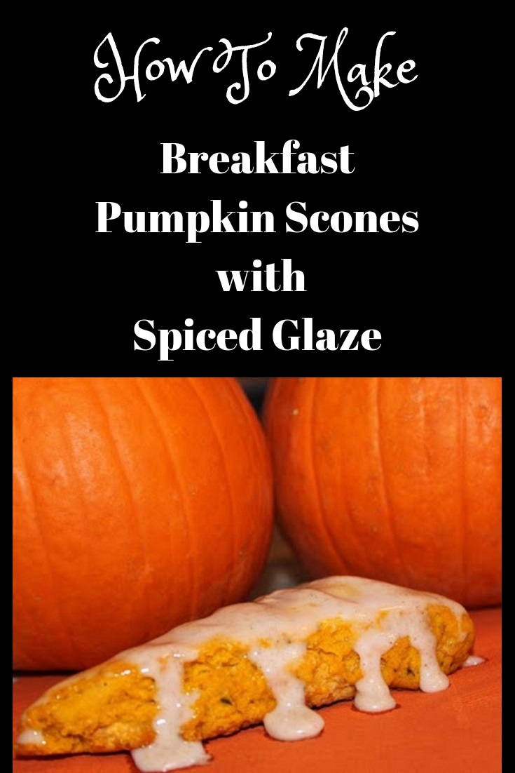 this is how to make the perfect pumpkin scones with a spiced glaze icing on top. These breakfast scones are sitting on top of an orange napkin and there are two sugar pie pumpkins in the background getting ready to be baked to make puree with. These scones are all handmade cut and from scratch recipe.