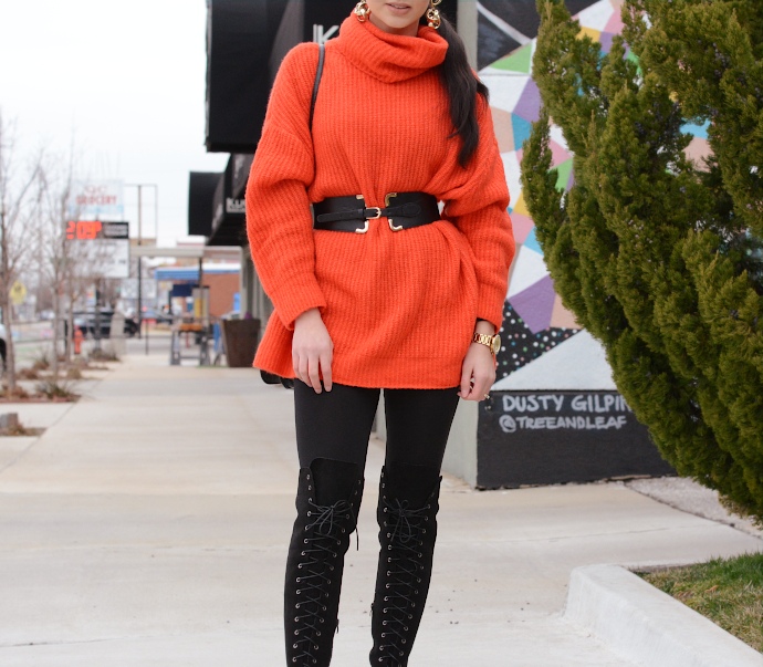 orange turtle neck knit sweater, over the knee lace up boots, waist belt