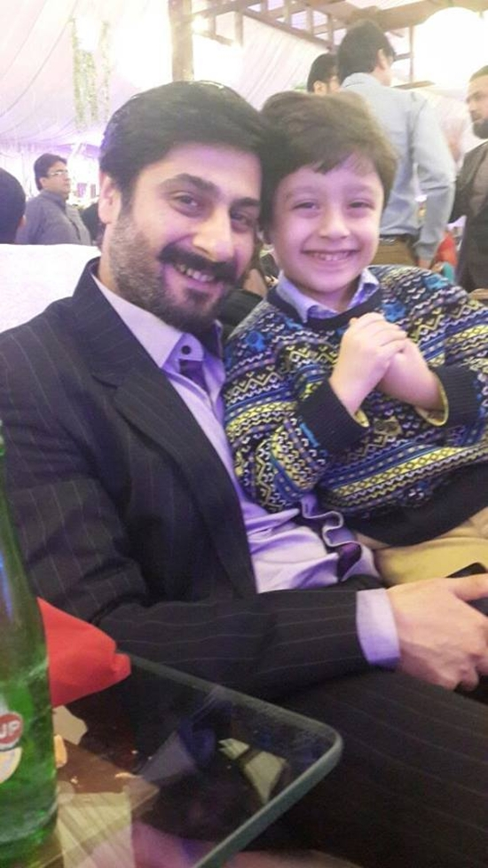 Kamraan Jeelani with his son