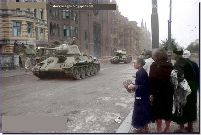 Old German women watch  Russian tanks streets  Berlin May 1945