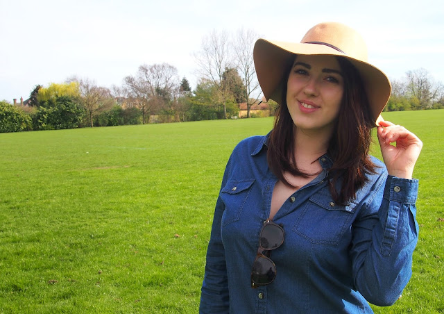 Girl in park with dress and hat on