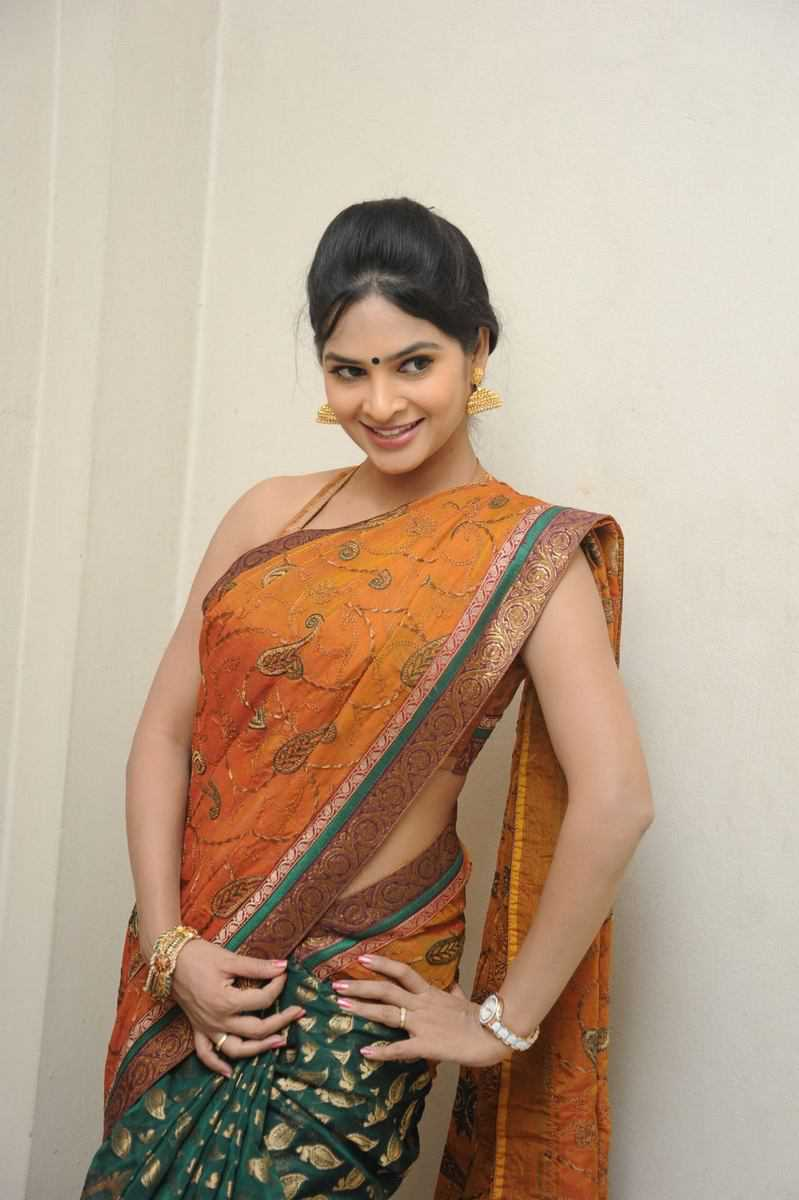 Tollywood Actress Hip Navel Show In Yellow Saree Madhumitha