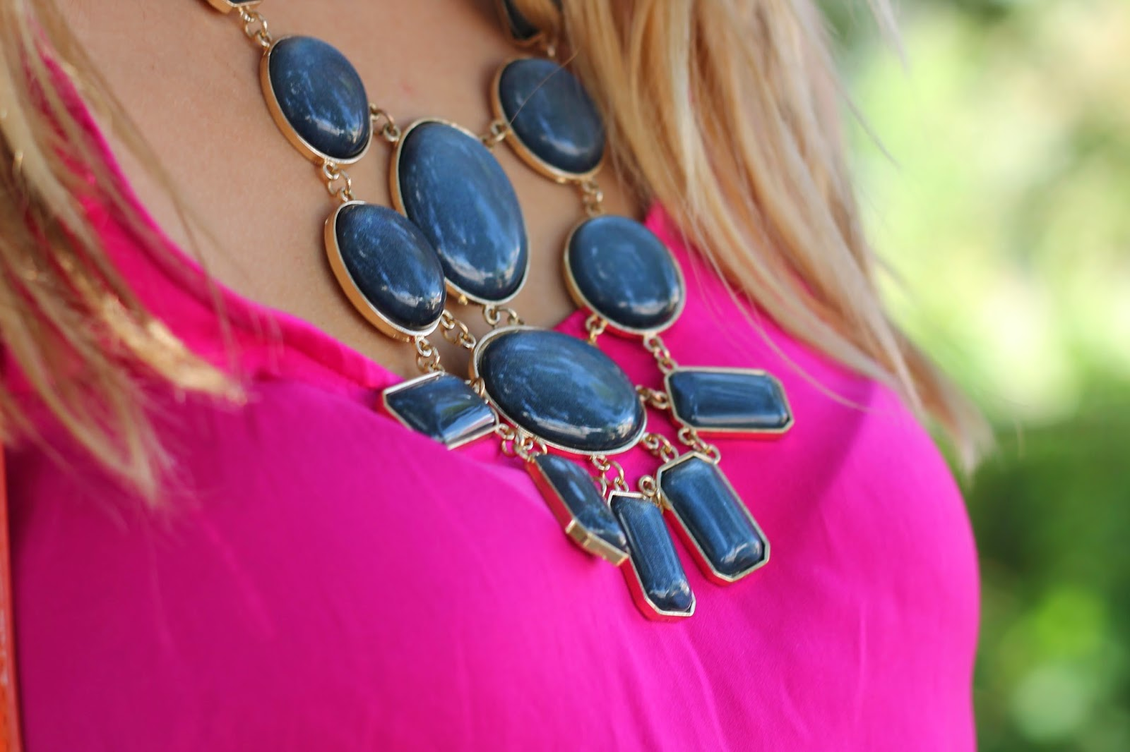 beautiful statement necklace with pink top