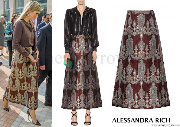 the Queen wore a printed silk blend skirt by ALESSANDRA RICH which is a London outfit brand. The printed silk blend skirt retails for 825.00 € with 40 percent discount on MYTHERESA website