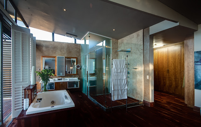 Large modern bathroom with glass shower