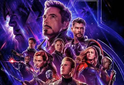 Avengers-endgame actors posters on blue display