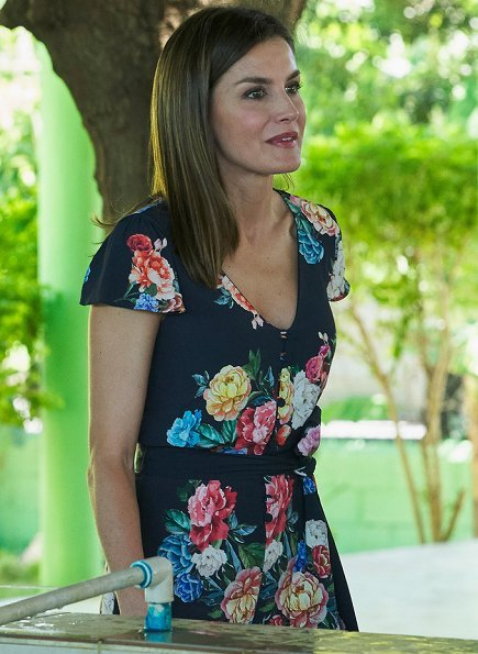Queen Letizia of Spain visited organic banana cooperative in Tramojos de Azua town. Queen Letizia wore V-neck floral jumpsuit and Magrit pumps