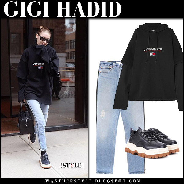 Gigi Hadid in black oversized sweatshirt vetements and jeans re/done model street style april 10