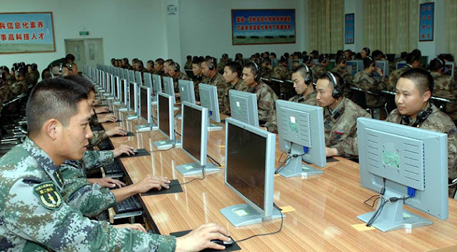 chinese military at computers possibly hacking
