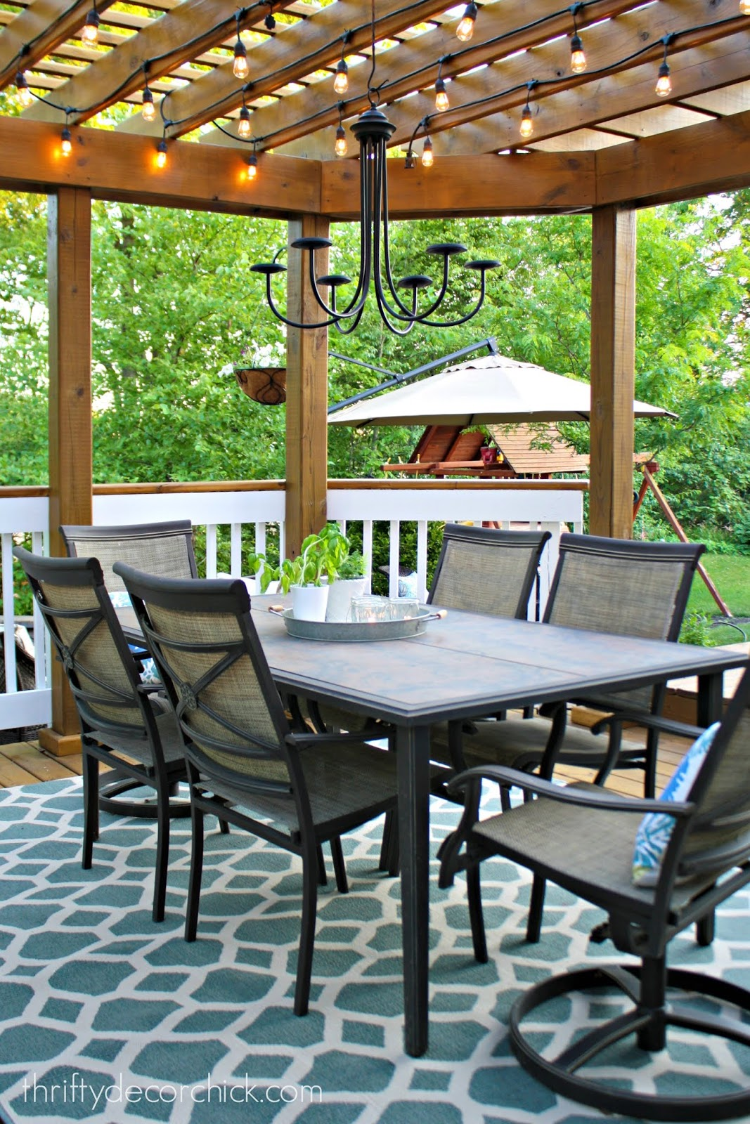 Pergola on deck with table and chairs
