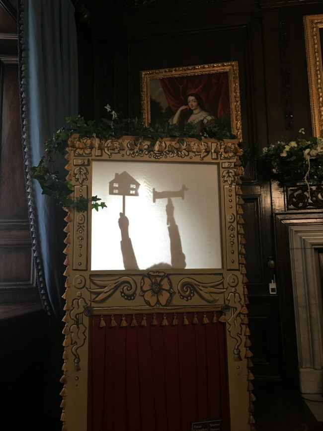 boy-doing-show-puppets-at-tredegar-House-shadow-theatre