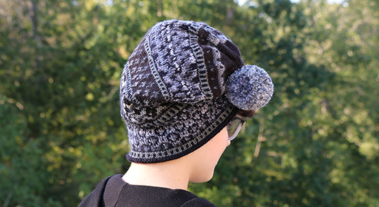 Gray and Black Knit Slouchy Scandinavian Hat Worn with Pompom Brought Up and Forward