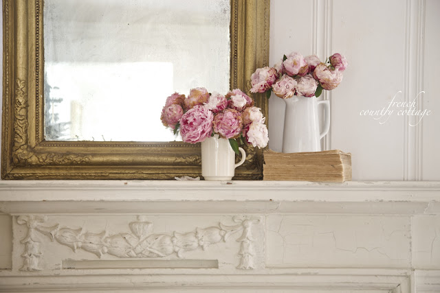 French Country Cottage Fireplace Mantel with peonies and old books