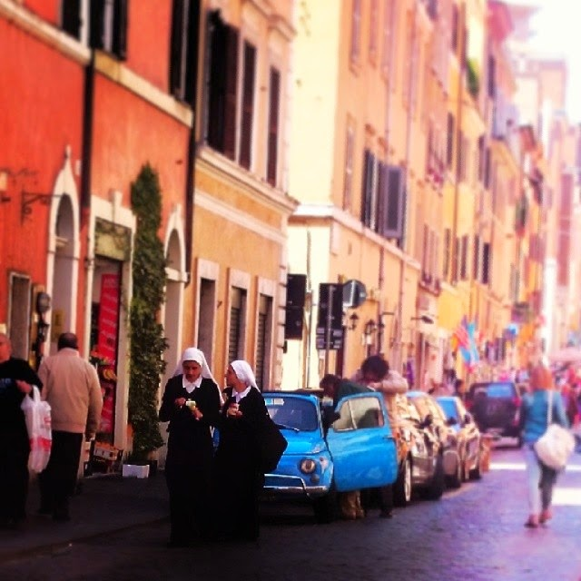 Nuns and a Fiat 500 on the streets of Rome Italy