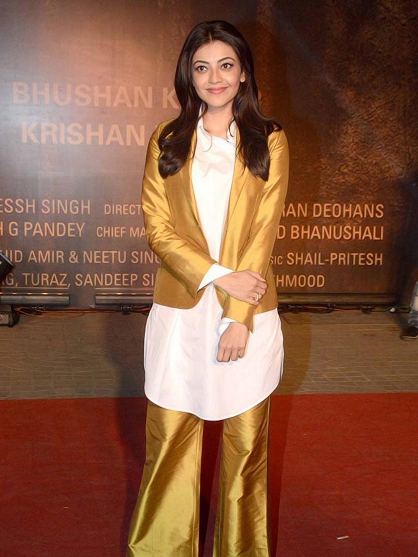 Kajal Agarwal Hot Photoshoot At Movie Screening In Yellow Dress