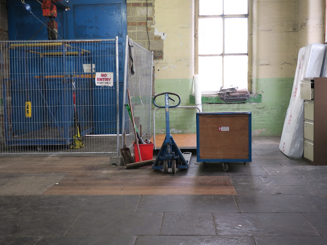 Cleaning materials, fork lift and trolley in old warehouse