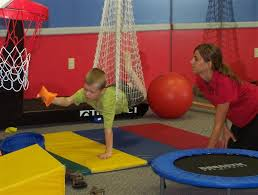 PT and child playing in Therapy Gym