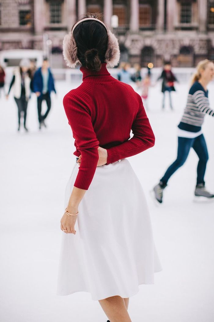 image result for woman in red turtleneck and earmuffs iceskating