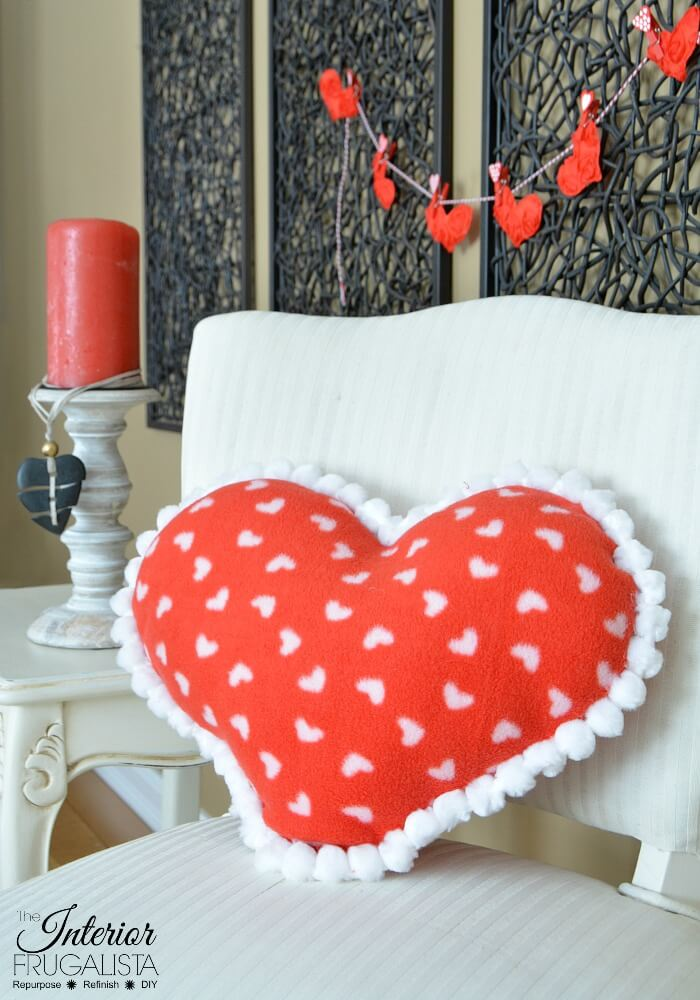 If you can sew a straight line then you can make this adorable fleece heart pillow for Valentine's Day in less than 15 minutes. Sewing machine optional!
