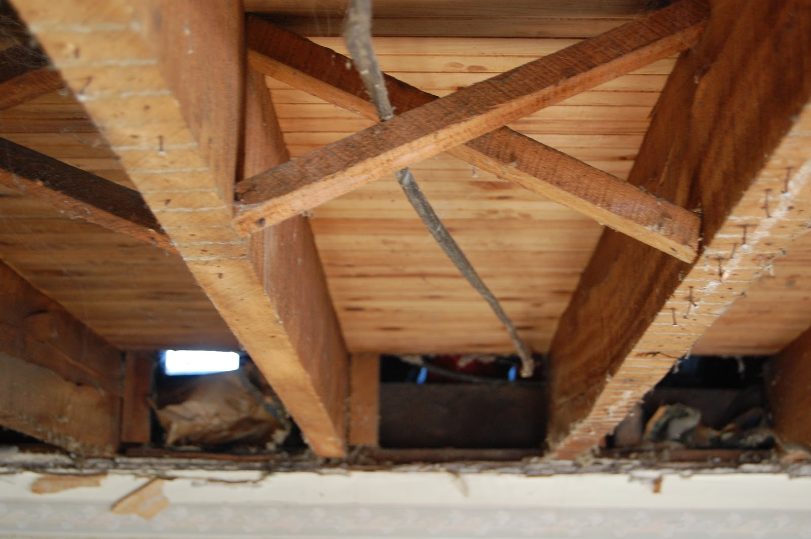 THE.BURK.HAUS: living room exposed floor joists mayhem